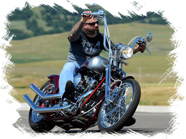 Hellion Custon Cycles ower, Bill Raber, riding one of his custom motorcycles.